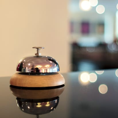 sales training services as a front desk bell on a glass table