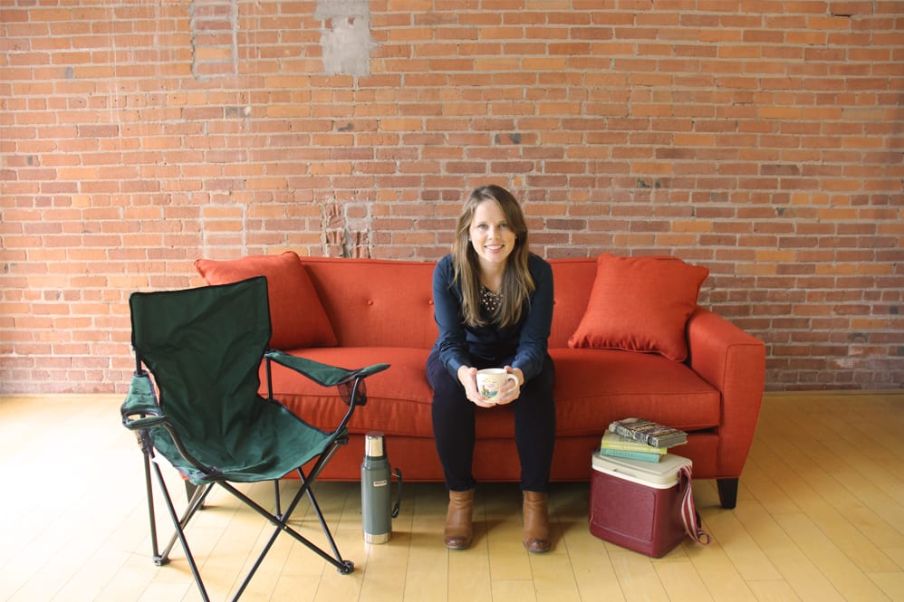 Ashley on couch with camping gear